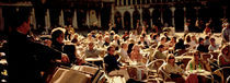 Tourists Listening To A Violinist At A Sidewalk Cafe, Venice, Italy by Panoramic Images