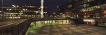 Buildings in a city lit up at night, Sergels Torg, Stockholm, Sweden by Panoramic Images