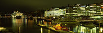 Buildings in a city lit up at night, Sodermalm, Slussplan, Stockholm, Sweden von Panoramic Images