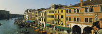 Tourists looking at gondolas in a canal, Venice, Italy von Panoramic Images