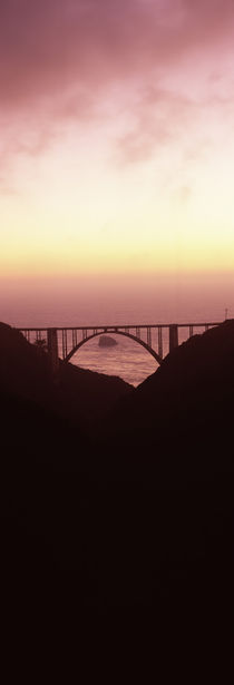 Silhouette of a bridge at sunset, Bixby Bridge, Big Sur, California, USA von Panoramic Images
