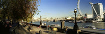 Ferris wheel at the riverbank, Millennium Wheel, Thames River, London, England by Panoramic Images