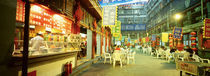Group of people sitting outside a restaurant, Beijing, China von Panoramic Images