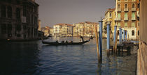 Tourists sitting in a gondola, Grand Canal, Venice, Italy by Panoramic Images