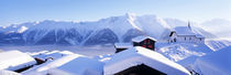 Snow Covered Chapel and Chalets Swiss Alps Switzerland von Panoramic Images