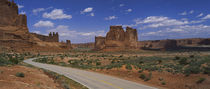 Empty road running through a national park, Arches National Park, Utah, USA by Panoramic Images