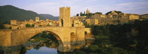 Arch bridge across a river in front of a city, Besalu, Catalonia, Spain by Panoramic Images