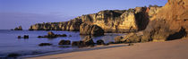 Portugal, Lagos, Algarve Region, Panoramic view of the beach and coastline by Panoramic Images