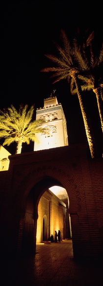 Low angle view of a mosque lit up at night, Koutoubia Mosque, Marrakesh, Morocco von Panoramic Images