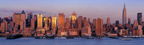 USA, New York, New York City, West Side, Skyscrapers in a city during dusk von Panoramic Images
