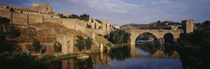 Castle at the waterfront, Puente de San Martin, Tajo River, Toledo, Spain by Panoramic Images