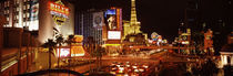 Buildings in a city lit up at night, The Strip, Las Vegas, Nevada, USA von Panoramic Images