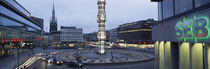 Buildings in a city lit up at dusk, Sergels Torg, Stockholm, Sweden by Panoramic Images
