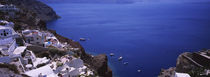 High angle view of a town at the waterfront, Oia, Santorini, Greece by Panoramic Images