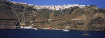 Town on a hill at the waterfront, Fira, Santorini, Greece by Panoramic Images