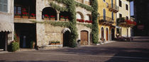 Houses at a road side, Torri Del Benaco, Italy by Panoramic Images