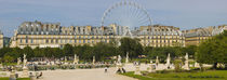Tourists in a garden, Jardin de Tuileries, Paris, Ile-de-France, France by Panoramic Images