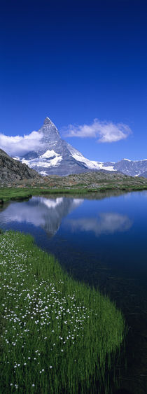 Reflection of a mountain in water, Riffelsee, Matterhorn, Switzerland by Panoramic Images