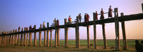 Myanmar, Mandalay, U Bein Bridge, People crossing over the bridge von Panoramic Images