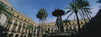 Fountain in front of a palace, Placa Reial, Barcelona, Catalonia, Spain by Panoramic Images