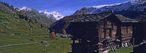 Log cabins on a landscape, Matterhorn, Valais, Switzerland von Panoramic Images