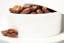 coffee beans in a cup I by Wolfgang Hielscher