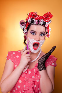 Woman shaving by Calin Molovan