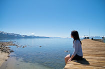 Girl at a pier at vacation resort by pixinity