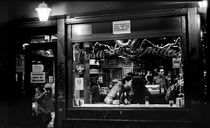Lovers kiss in a cafe. Madrid, 2011 by Maria Luros