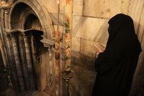 Bethlehem, a prayer at the Church of the Nativity by Hanan Isachar