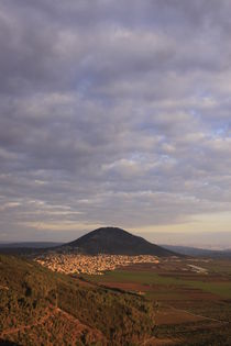 A view of Jezreel valley and Mount Tabor at dusk by Hanan Isachar