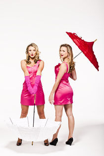 Blonde twins in pink dresses by vito vampatella