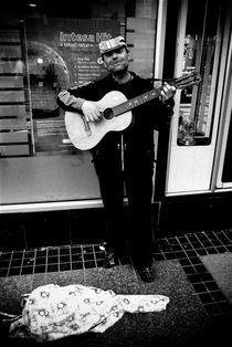 Street guitarist by Ivan Aleksic