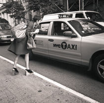 Woman paying taxi: New York City by Ron Greer