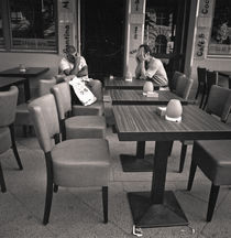 Two menn at a cafe: Berlin by Ron Greer