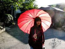 Teenager with umbrella by Andrea Liuzza