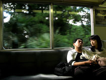 Couple in train by Andrea Liuzza