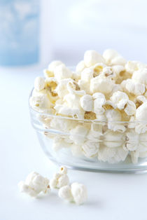 pop corn in a glass bawl  by Kris Shopov
