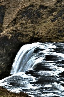 The top of Skogafoss waterfall Iceland by Simeon Jones
