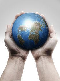 Man's hands holding a globe by Bombaert Patrick