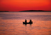 Fishing from a canoe, Martha's Vineyard, USA by John Greim
