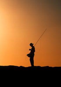 Boy fishing. by John Greim