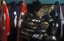 Soccer cleats and game jerseys. by John Greim