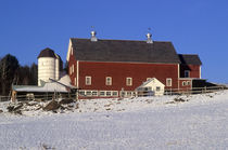 Red barn with snow covered field. by John Greim