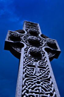 Celtic high cross at dusk. by John Greim