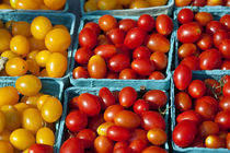 Cherry tomatoes at farmers market. by John Greim
