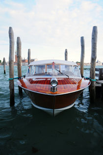 Venice water taxi by Ronnie Peters