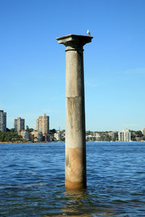 Sandstone column standing in the water by michal gabriel