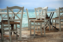 chairs in empty Greek restaurant by michal gabriel