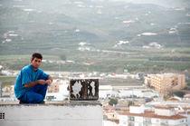 Man on Roof - Vélez-Málaga, Spain by Michael Bastianelli